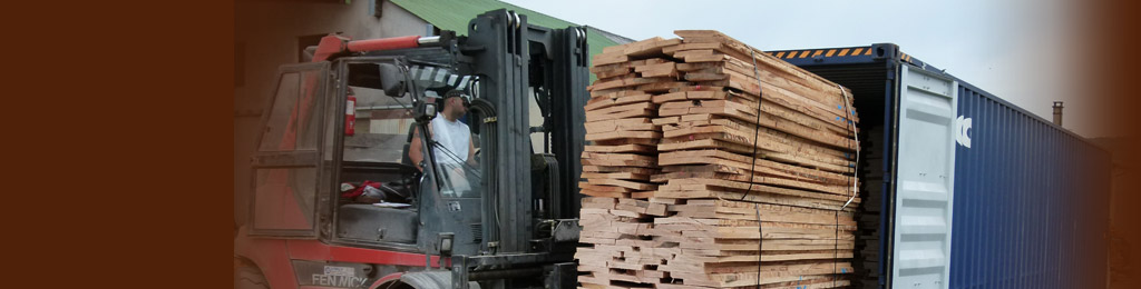 Loading a container of dried beech boards for export
